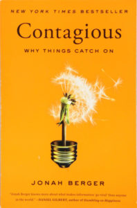 "The cover of the book ""Contagious"" by Jonah Berger."